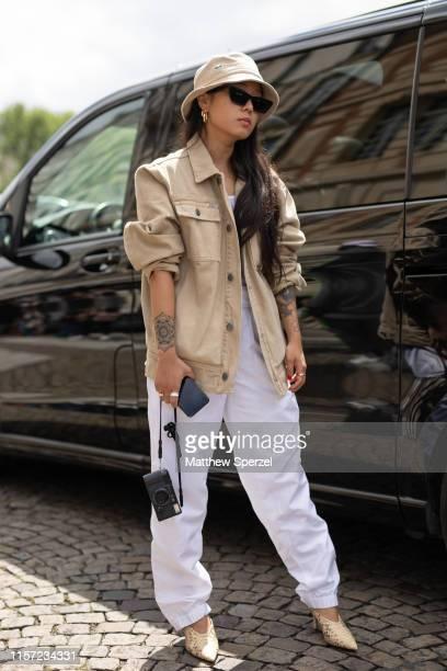 Christina Paik is seen on the street during Men's Paris Fashion Week wearing Louis Vuitton on June 20, 2019 in Paris, France.