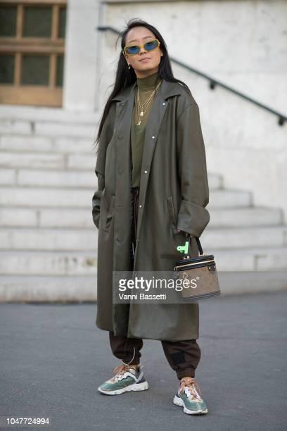 Christina Paik poses wearing Nike shoes and Louis Vuitton bag after the Sacai Show at the Palais de Tokyo during Paris Fashion Week SS19 Womenswear...