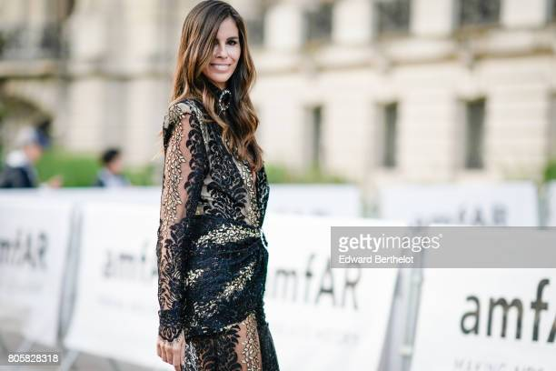 Christina Pitanguy wears a lace dress outside the amfAR dinner at Petit Palais during Paris Fashion Week Haute Couture Fall/Winter 20172018 on July 2...
