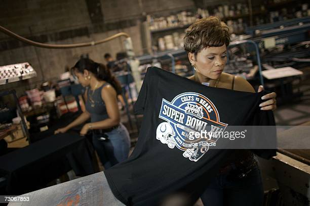 Christina Ramos and Nery Reyes work on printing Super Bowl XLI teeshirts at 1 Stop Promo's January 22 2007 in Miami Florida Local business's are...