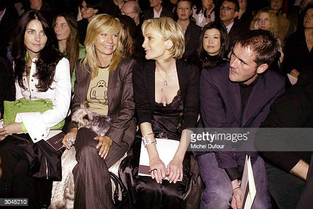 Christina Reali, Natty Belmondo, and Patricia Kaas with her friend all attend the Celine Ready-To-Wear Fall-Winter 2004-2005 fashion collection March...