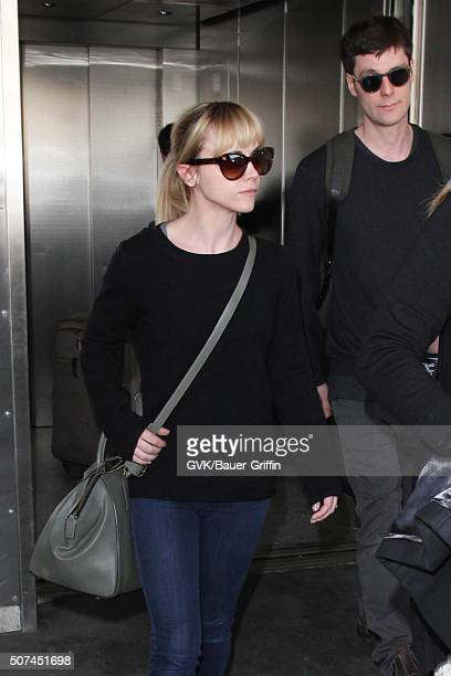 Christina Ricci and James Heerdegen are seen at LAX on January 29, 2016 in Los Angeles, California.