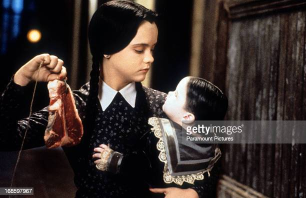 Christina Ricci dangling meat in a scene from the film 'Addams Family Values' 1993