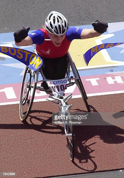 Christina Ripp celebrates as she breaks the tape to win the women's wheelchair division during the 107th running of the Boston Marathon on April 21...