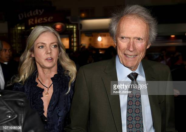 Christina Sandera and Clint Eastwood arrive at the premiere of Warner Bros Pictures' The Mule at the Village Theatre on December 10 2018 in Los...