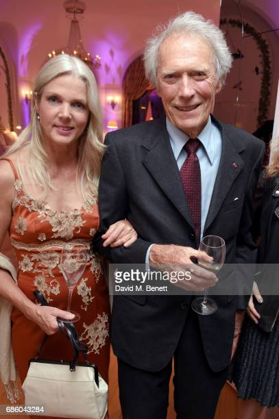 Christina Sandera and Clint Eastwood attend the Vanity Fair and HBO Dinner celebrating the Cannes Film Festival at Hotel du Cap-Eden-Roc on May 20,...