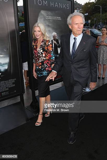"Christina Sandera and director Clint Eastwood attend a screening of Warner Bros. Pictures' ""Sully"" at Directors Guild Of America on September 8, 2016..."
