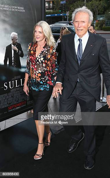 Christina Sandera and director Clint Eastwood attend a screening of Warner Bros Pictures' Sully at Directors Guild Of America on September 8 2016 in...