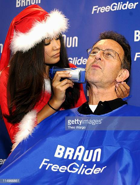 Christina Santiago 2003 Playmate of the Year using the Braun Free Glider shaver on volunteers Photo by Theo Wargo/WireImage for Porter Novelli