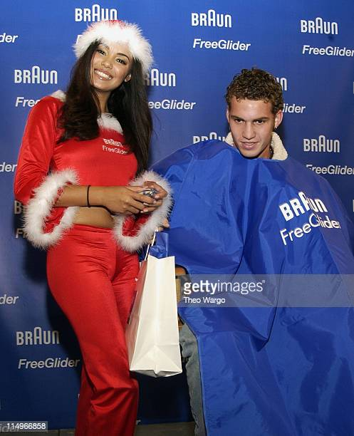 Christina Santiago 2003 Playmate of the Year using the Braun Free Glider shaver on volunteer Photo by Theo Wargo/WireImage for Porter Novelli
