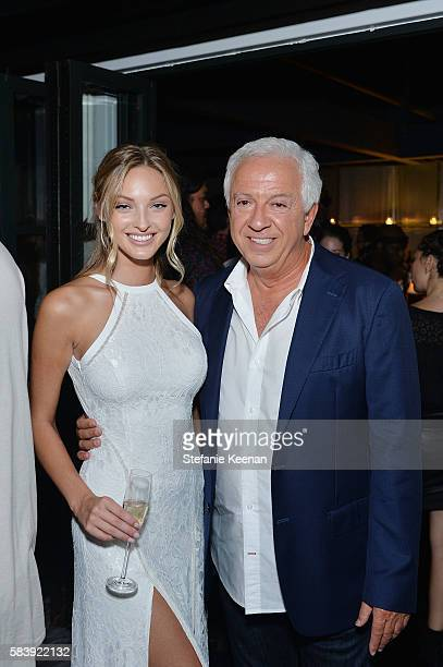 Christina Sather and Paul Marciano attend GUESS Dare Double Dare Fragrance Launch at Ysabel on July 27 2016 in West Hollywood California