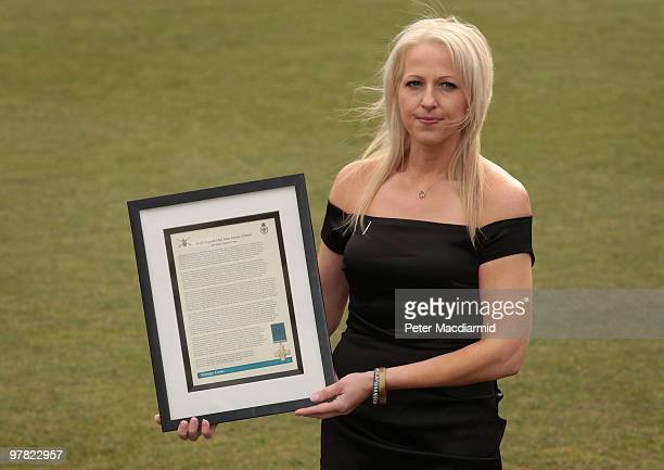 Christina Schmid widow of Staff Sergeant Olaf Schmid stands with her late husband's citation at The Honourable Artillery Company on March 18 2010 in...