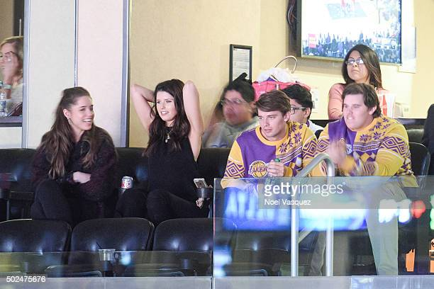 Christina Schwarzenegger, Katherine Schwarzenegger, Patrick Schwarzenegger and Christopher Schwarzenegger attend a basketball game between the Los...