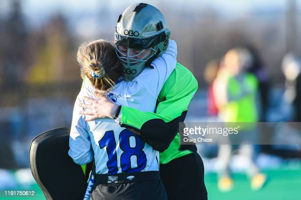 Christina Seery of Franklin Marshall consoles teammate Addie Peters following the Division III Women's Field Hockey Championship held at Spooky Nook...