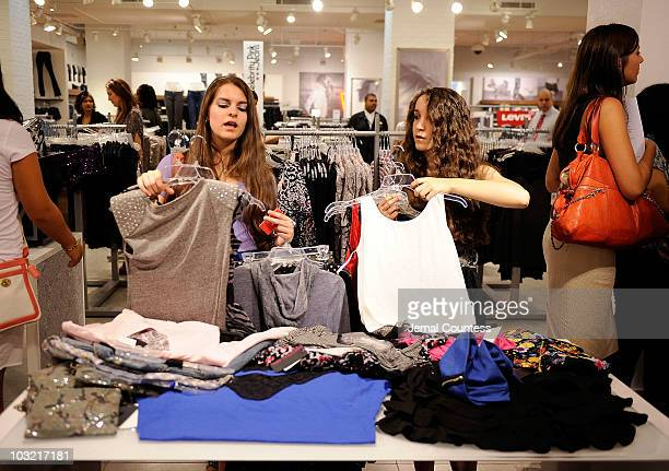 Christina Sikic and Jennifer Sikic of Staten Island NY sort through pieces from the �Material Girl� clothing line by Madonna at the Material Girl...