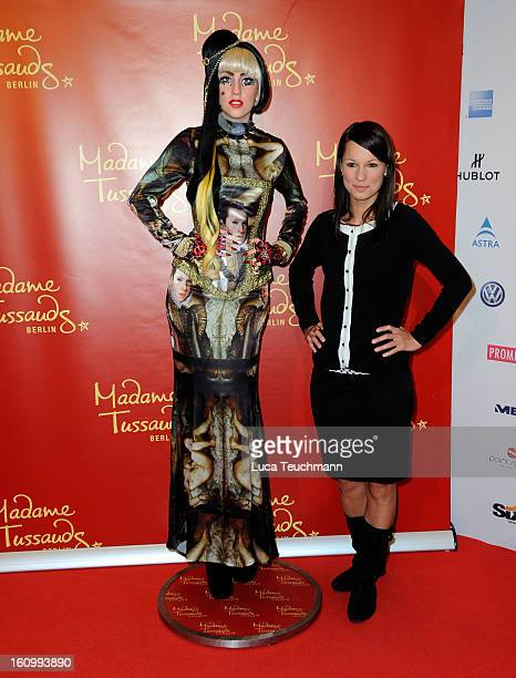 Christina Stuermer poses with a waxwork model of Lady Gaga as she attends the Movie Meets Media Gala during the 63rd Berlinale International Film...