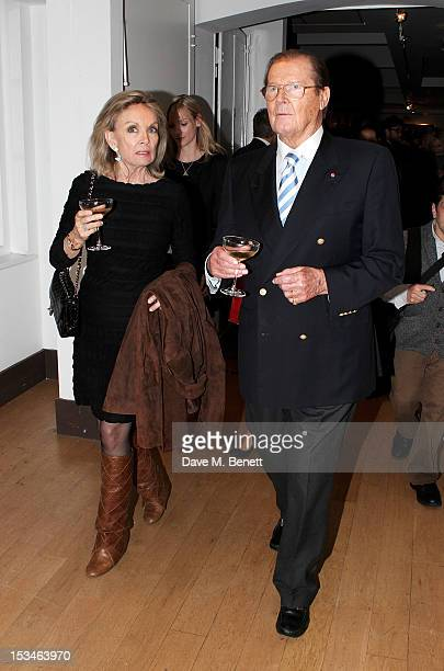 Christina Tholstrup and Sir Roger Moore attend '50 Years Of James Bond The Auction' celebrating the 50th anniversary of the film franchise and the...