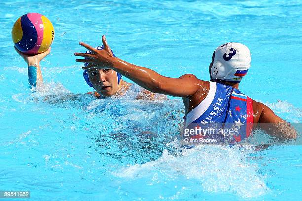 Christina Tsoukala of Russia tries to block the pass by Ekaterina Prokofyeva of Greece in the Womens Water Polo Bronze Medal Match during the 13th...