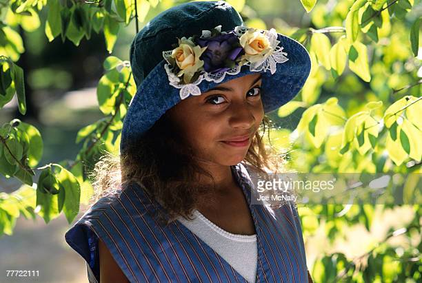 "Christina Vidal poses under a tree in June 1993 in a park in New York City. Vidal played ""Angie Vega"" in the 1993 Michael J. Fox movie 'Life With..."