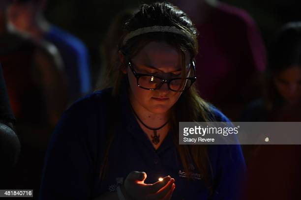 Christina Walls participates in a candlelight vigil at the University of Louisiana Lafayette on July 24 2015 in Lafayette Louisiana Two people were...