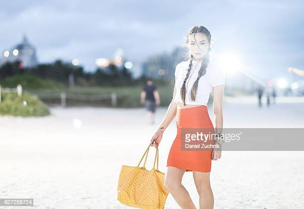 Christina Walsh is seen outside of the Scope Art Show wearing a BCBG skirt Misguided top and Goyard bag during Art Week Miami 2016 on December 2 2016...