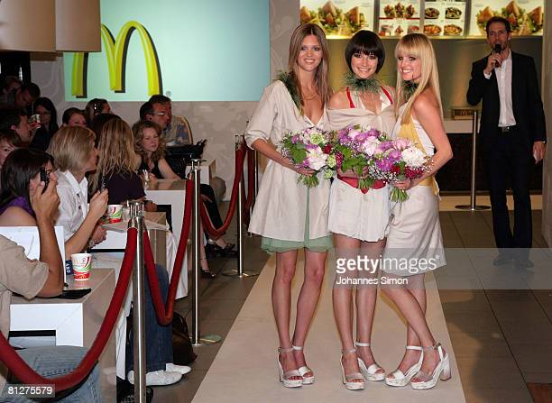 Christina Wanda and Caro participants of Heidi Klum' casting show Germany's Next Super Model pose during the presentation of three new designed...