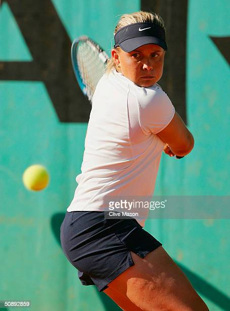Christina Wheeler of Australia returns serve in her first round match against Marta Marrero of Spain during Day One of the 2004 French Open Tennis...