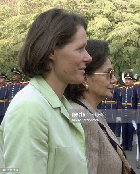 Christina , wife of German President Johannes Rau, inspects honor guards with Suzanne Mubarak, wife of Egyptian President Hosni Mubarak, at Cairo...