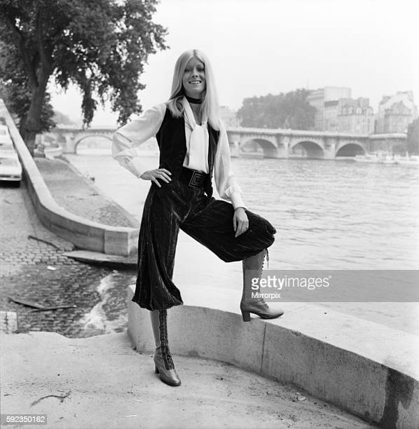Christine 20 year old model on the banks of the Seine wearing Rasberry crushed velvet golf knickers with green velvet waistcoat and white silk blouse...