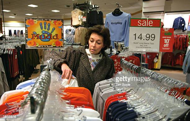 Christine Abbate shops for Christmas items for her 13-year-old daughter November 22, 2002 at a JC Penney store at Woodfield Mall in Schaumburg,...
