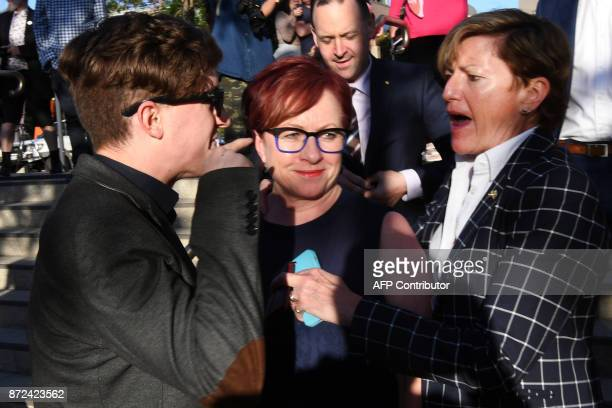 Christine Abbott sister of Australia's former prime minister Tony Abbott is jostled by protesters as she attends a Liberal Party fundraiser in Sydney...
