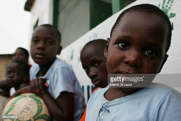 Christine an HIV positive orphan cries at the Aidchild Orphanage on December 6 2005 in Mpigi 60 km north of the capital Kampala Uganda Christine was...