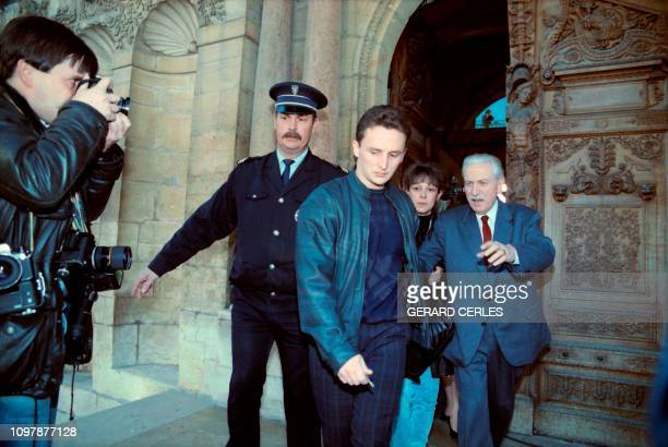 Christine and JeanMarie Villemin with their lawyer HenryRené Garaud leave the court of Dijon on November 3 1988 after a general confrontation of the...