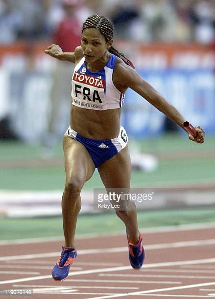 Christine Arron anchors France's women's 400 relay to victory in 4178 seconds in the IAAF World Championships in Athletics at Stade de France on...