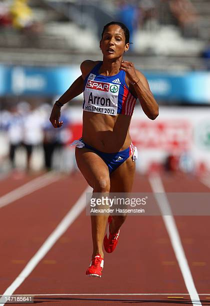 Christine Arron of France competes in the Women's 100 Metres Heats during day one of the 21st European Athletics Championships at the Olympic Stadium...