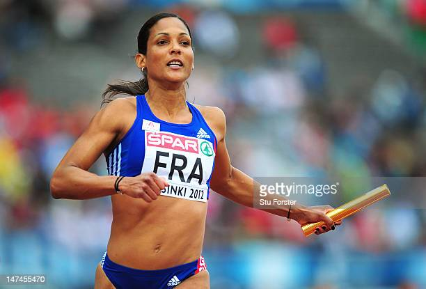 Christine Arron of France competes in the Women's 4x100 Metres Relay Semi Finals during day four of the 21st European Athletics Championships at the...