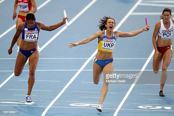 Christine Arron of France wins the silver and Yelizaveta Bryzhina of Ukraine wins the gold medal in the Womens 4x100m Relay Final during day six of...