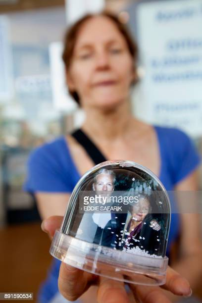 Christine Assange mother of Wikileaks founder Julian Assange displays a snow dome photograph of her and her son before reading an open letter for...