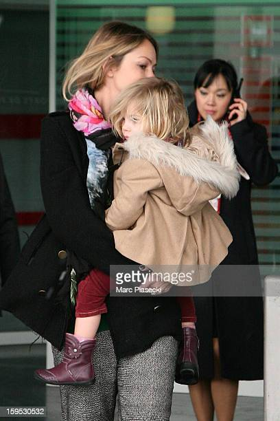 Christine Baumgartner and her daughter Grace Avery are seen at Roissy airport on January 15 2013 in Paris France