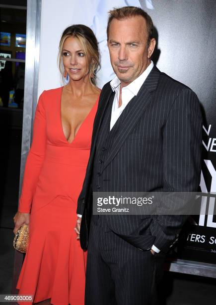Christine Baumgartner and Kevin Costner arrives at the 3 Days To Kill at ArcLight Cinemas on February 12 2014 in Hollywood California