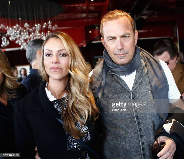 Christine Baumgartner and Kevin Costner attend the 2014 Leigh Steinberg Super Bowl Party at 230 Fifth Avenue on February 1, 2014 in New York City.