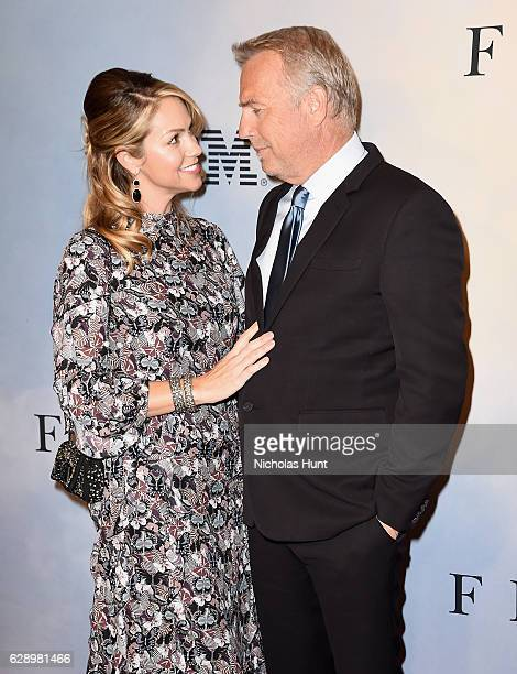 Christine Baumgartner and Kevin Costner attend the Hidden Figures New York Special Screening on December 10 2016 in New York City