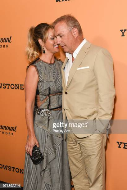 Christine Baumgartner and Kevin Costner attend the premiere of Paramount Pictures' Yellowstone at Paramount Studios on June 11 2018 in Hollywood...