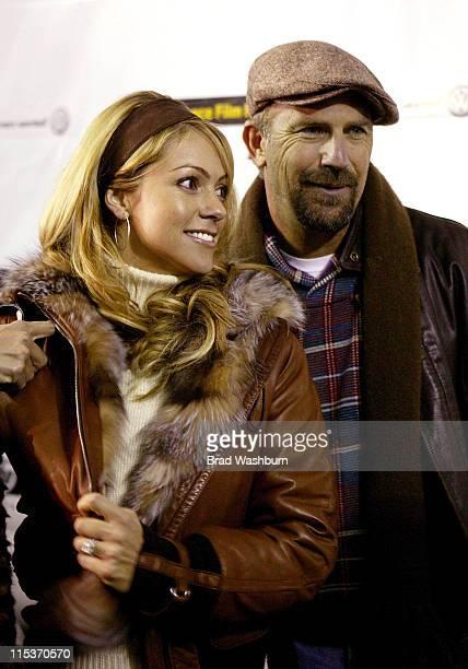 "Christine Baumgartner and Kevin Costner during 2005 Sundance Film Festival - ""The Upside of Anger"" Premiere at Eccles Theatre in Park City, Utah,..."