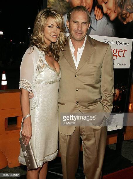 "Christine Baumgartner and Kevin Costner during ""The Upside of Anger"" Los Angeles Premiere - Arrivals at The Mann's National Theatre in Westwood,..."