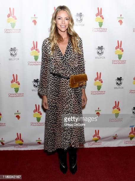 Christine Baumgartner attends Omnipeace 2nd Annual Gala Rwanda Rocks Charity Event at Vibrato Jazz Grill on November 4 2019 in Los Angeles California