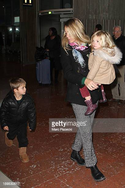 Christine Baumgartner her son Hayes and her daughter Grace Avery are seen at Roissy airport on January 15 2013 in Paris France