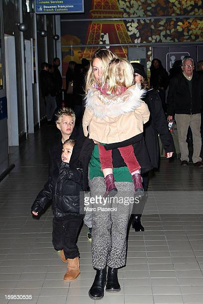 Christine Baumgartner her sons Hayes and Cayden and her daughter Grace Avery are seen at Roissy airport on January 15 2013 in Paris France