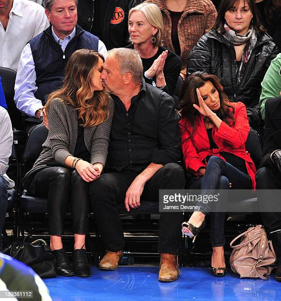 Christine Baumgartner Kevin Costner and Eva Longoria attend the Dallas Mavericks vs New York Knicks game at Madison Square Garden on February 19 2012...
