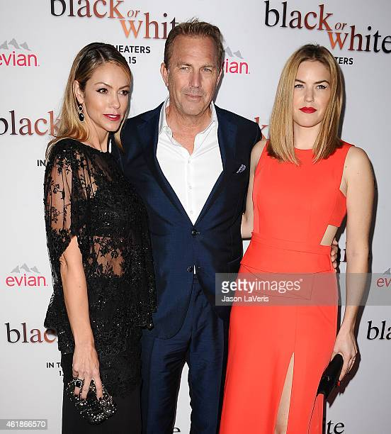Christine Baumgartner Kevin Costner and Lily Costner attend the premiere of 'Black or White' at Regal Cinemas LA Live on January 20 2015 in Los...